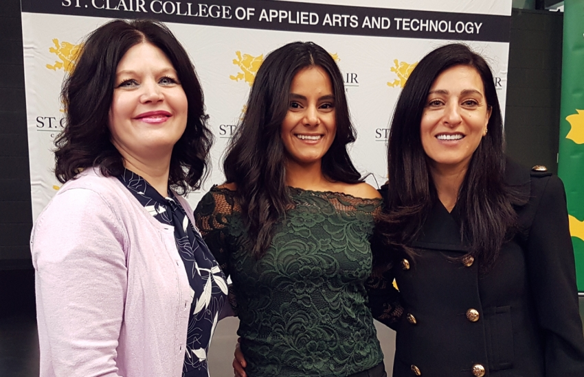St. Clair College President, Patti France, computer systems networking program grad, Zaenab Allawi and Rola Dagher, President of CISCO Canada.