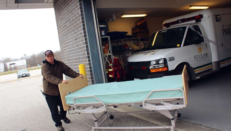 Dave Purdie pushes out an extra hospital bed.